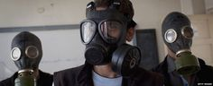 Syrians in masks,there own goverment using chemical weapons against it's population.