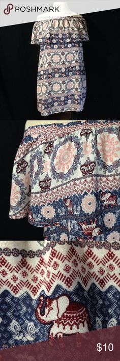 "Rue21 Cold Shoulder Eastern Elephant Print Tunic Bust 39"" Length 27"" This Tunic is in excellent used condition. Material does not stretch. Top shell is made from a thin material and the under lining is a thick material. Rue21 Tops Tunics"