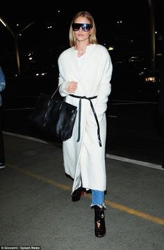 Flying solo? Rosie Huntington-Whiteley was headed onto a different kind of runway on Monday night as she caught a flight out of Los Angeles