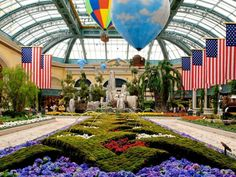 Visit this must-see colorful gorgeous indoor garden at the Bellagio Conservatory and Botanical Gardens, Las Vegas, Nevada Top 10 Honeymoon Destinations, Honeymoon Trip, Honeymoon Island, Wedding Destinations, Honeymoon Ideas, Vacation Places, Vacation Ideas, Travel Destinations, Bellagio Conservatory
