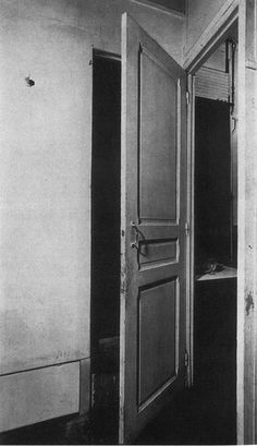 """Duchamp's Door 11 rue Larry Originally part of the artist's studio in Paris this one door serves two doorways. As a result, when it swings on its hinges to close entrance to one room, it opens another, therefore defying the French proverb """"A door must be either open or shut."""""""