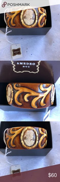 "Amedeo NYC Cameo Bracelet 8.5"" NEW NEVER WORN. 3 UNIQUE HAND-CARVED CORNELIAN SHELL OVAL CAMEOS AMEDEO NYC RESIN HAND-CARVED CAMEO 1 1/4"" BANGLE CUFF. 8.5"" DIAMETER BANGLE; 1 1/4"" WIDTH (FITS 7""-8.5"" WRISTS) RICH BROWN & IVORY RESIN; VINE DESIGN POLISHED FINISH W/ ROUNDED EDGES. BOX INCLUDED Amedeo NYC Jewelry Bracelets"