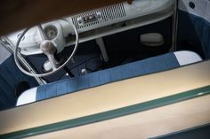 VW camper interior, pretty practical(ish) seat color love the needle cord? lining.  Dub Interiors