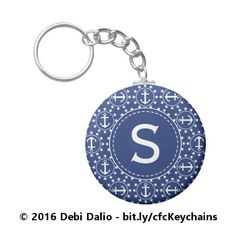 For boating enthusiasts and other maritime buffs, this stylish key ring with a nautical theme features a repeating pattern of white anchors inside circles surrounded by stars on top of a navy blue background. The design is topped with a navy blue circle containing a customizable initial. https://www.zazzle.com/white_anchors_and_stars_on_navy_nautical_monogram_keychain-146172556694572413?rf=238083504576446517&tc=20170203_pint_TA #travel #accessories #boating #StudioDalio #Zazzle