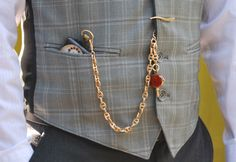pocket watch & Albert chain (with t-bar), worn from vest buttonhole to vest pocket, featuring a gemstone fob on the drop