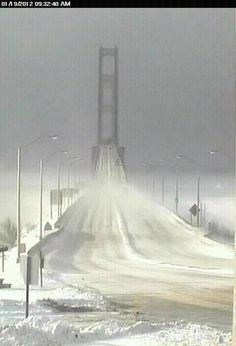 Mackinac Bridge in winter: if you shut downs schools for an inch of snow, your never gonna get to the U.P in winter!