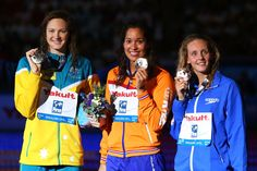 (L-R) Silver medal winner Cate Campbell of Australia, Gold medal winner Ranomi Kromowidjojo of the Netherlands and Bronze medal winner Francesca Halsall of Great Britain celebrate on the podium after the Swimming Women's Freestyle 50m Final on day sixteen of the 15th FINA World Championships at Palau Sant Jordi  on August 4, 2013 in Barcelona, Spain.