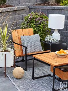 Industrial style has been incorporated into almost every room of the house, so why not add it to the patio? See how to make this #DIY lounge chair with cedar boards and steel pipes. Custom furniture is easier than you might think, so give it a try! #patiofurniture #outdoordiyplans