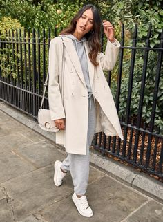Layer up your favourite loungewear with a tailored coat. The ultimate cosy outfit when out and about.