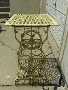 Upcycled Antique Sewing Machine Base with Cast Iron Register Grate Top.  Cute!