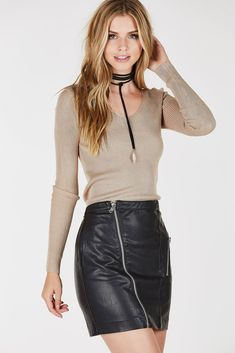 Ribbed long sleeve top with wide V-neckline. Straight hem with body hugging fit. - Rayon-Nylon blend - Imported - Model is wearing size S - Runs true to size - Hand wash cold