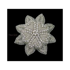 This exquisite vintage inspired hair flower is heavily beaded with sparkling crystal diamante and silver beads set on a flexible fabric backing for comfort with a simple crocodile clip for versatility of wear.