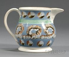 Mochaware Jug, Britain, early 19th century, baluster-form pearlware jug with rust, white, and black slip looping earthworm and cat's..