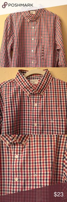 Men's Dockers shirt Dockers long sleeve men's shirt with button down collar; new with tags never worn; left chest pocket with logo; white button down with matching buttons on sleeves that can also be folded upwards for a casual look; red, white & blue plaid; size M; cotton / polyester; a classic look great for business casual or jeans; great condition Dockers Shirts Casual Button Down Shirts
