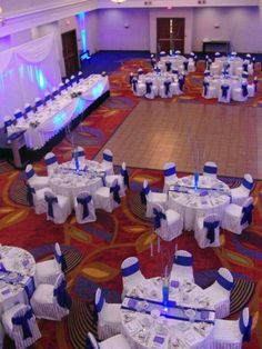 Add more blue lighting, silver and crystal accents, darker center pieces & lights around dance floor.....