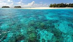 Kiribati ....Beautiful place to visit the people are very friendly fishing is great.