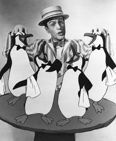Dick Van Dyke (Bert) and the wait staff - Mary Poppins publicity still, 1964