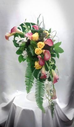 Yellow and pinks cascading bouquet.