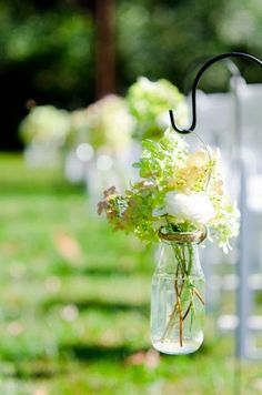 Rustic Outdoor wedding Decor: Hanging wrapped jars for you ceremony :  wedding bottles ceremony jars glass rustic vintage outdoor wedding silver inspiration reception Down The Aisle 1a