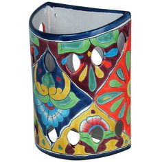 Talavera ceramic wall sconces add a spot of bold color to any wall. Handmade in Mexico.
