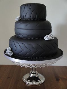 Tires wedding cake ~ You really have to love him to have this cake but a great groom's cake for a NASCAR themed wedding