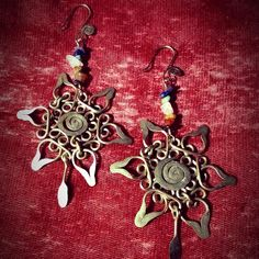 Thanks @hippie_outfitters for showcasing our chakra balancing earrings in our original flower of life signature design! DM us for more info. #chakra #chakras #chakrastones #yoga #yogi #sacredgeometry #boho #bohochic #artesania #wirejewelry #handmadejewelry #handmade #hechoamano #feitoamao #wirewrapped #floweroflife #artesano #artisan #garnet #carnelian #tigerseye #rosequartz #turquoise #lapislazuli #amethyst #stunning #luxury #exotic #spiritual Wire Jewelry, Handmade Jewelry, Chakra Balancing, Chakra Stones, Flower Of Life, Signature Design, Carnelian, Sacred Geometry, Chakras
