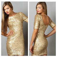 """Mod Cloth Gold Dust Gal sequined dress M Mod Cloth Gold Dust Gal sequined dress sized Medium. SOLD OUT! This is a gorgeous, figure-flattering gold sequined dress from Mod Cloth, made by Ark & Co. Only worn once to a class reunion. This dress has stretch to it, a flattering sleeve length & scoop back. The length is 35"""", bust measured flat (so double) 17"""", waist is 15"""", hips are 17"""", but like I said, the dress has stretch to accommodate some extra room. If you have any other questions please…"""
