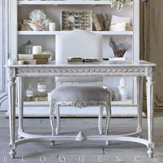 Eloquence® Contessa Entry Table in Chipped White Eloquence® Contessa Entry Table. A gorgeous French-inspired piece for your front hall, or equally fabulous as a desk or vanity! In weathered Chipped White finish with gilt highlights, and white marble top.