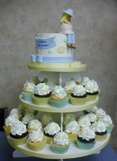Landon's Baby Shower - Cupcake tower for a baby shower with a fondant pregnant women topper.  I know people make these toppers all the time but, I think mine are getting better and I was really happy with this one