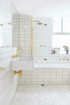 Love the White tiles and gold trim