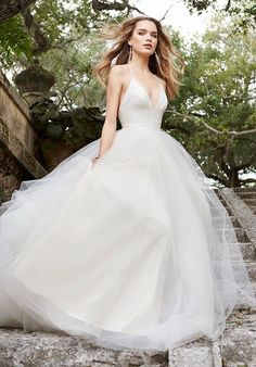 Ivory Tulle bridal ball gown, lace bodice with halter neckline, T -strap back, sweep train.