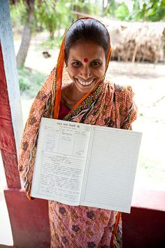 Sholuta is a member of this village's Water Committee. She proudly shows how they keep record of every family's financial contribution to make sure they have enough funds for any well maintenance or repairs. To date, we have 240 completed projects in India through our local partners Water for People.