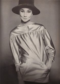 1962  Vicomtesse de Ribes in Saint Laurent's platinum gray satin evening smock over a dark, narrow pigeon-gray velvet skirt.