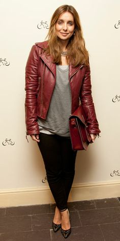 Louise Redknapp matching our oxblood satchel to her leather jacket at the opening of our pop up store in London's Shorts Gardens.