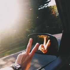 Cool pic, but if you're taking a pic of your left hand in the side view mirror, that means your right hand is holding the phone. So which hand is on the steering wheel...?