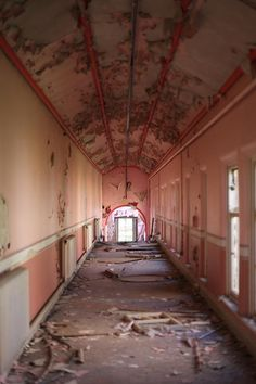 Whittingham Asylum (England) | 20 Haunting Pictures Of Abandoned Asylums. I think its more scary because its pink.