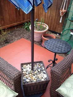 Thanks, Pinterest, for the umbrella stand idea!!  Fill it mostly with non-decorative rocks. No one will see those anyway, and it's cheaper that way. Top off the basket with polished river rocks.