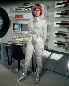 Dolores Mantez as Lieutenant Nina Barry on the TV Series UFO – 1969 – 1971 Dolores Mantez als Leutnant Nina Barry in der Fernsehserie UFO – 1969 – 1971 Science Fiction Kunst, Ufo Tv Series, Space Outfit, Space Girl, Space Age, Sci Fi Tv Shows, Sci Fi Movies, Retro Futurism, Carnival