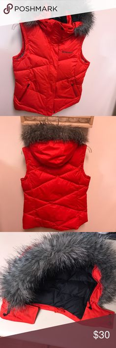 Columbia Winter Down Vest w/ Detachable Hood Columbia down vest with Omni-heat lining and detachable faux fur lined hood. This vest zips up the front but also has Velcro closure. There are two outside pockets on the front and an inside pocket with a hole for headphones. See pics for these details. It's very warm and cozy and a lovely bright tomato red color. Size M and in like new condition!! Bundle 3 or more items from my closets and save 30%!! 🌻 Columbia Jackets & Coats Vests