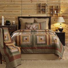 Inspired by vintage hunting shirts, Tallmadge Hand Quilted Patchwork Quilt ensemble features traditional rustic plaids with tones of campfire yellow, spruce green and woodsy brown. The log cabin patchwork design covers the quilt and shams with a green and orange plaid border. Hand-quilting is stitch in the ditch which emphasizes the strips of fabric used in each block. 100% Cotton Quilt. #patchwork, Quilts, #handquilted, #rustic, #HomeDecor, #Decor, #VHCBrands, #Yellow, #Green, #Red, #tan
