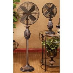 $240.00 - Gorgeous oscillating floor standing fan in copper finish.  Includes 3 speeds with a whisper quiet motor. - Free Shipping Camelot Living!