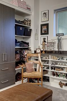 Chic and organized walk in closet design.  From a 4-story Craftsman style home construction by Lavallee Construction, discovered on Porch.com
