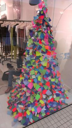 This is a really cool store display. The triangle shape represents a symbol of strength and power which is ironic because it is made of sticky notes which are weak and flimsy.