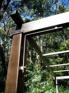 Beautiful rusted metal finish on designer metal decorative gardens of steel pergola is contemporary traditional architecture at its finest.