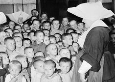 Some of Poland's thousands of war orphans at the Catholic Orphanage in Lublin, on September 11, 1946, where they are being cared for by the Polish Red Cross. Most of the clothing, as well as vitamins and medicines, are provided by the American Red Cross.