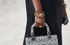 Chunky chain #bracelets and #rings at #PFW. Photo: The Street Muse. #LoveGold