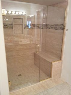 Walk-in shower ideas. Stone paneling in the shower surround.