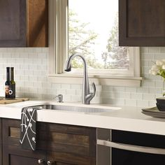 white glass tile backsplash, white countertop with dark wood cabinets - perfect!