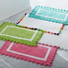 Pom-Pom Bath Mat #potterybarnteen; Lucy's bathroom-white mat with multi colored poms