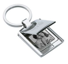 """Flip Top Key Chain Photo Frame Size: 3/4""""W x 3/4""""H Loved ones and memories, treasured moments and special souls, these can all be carried with you every day of your life, captured in print and then slid into this stylish flip top cover photo frame. Whenever you're feeling down or blue, simply pop out this chain, flip the top, and lose yourself in happier times, basking in the glow of the people who care for you most. This allows you to keep your joy in your pocket, right next to…"""
